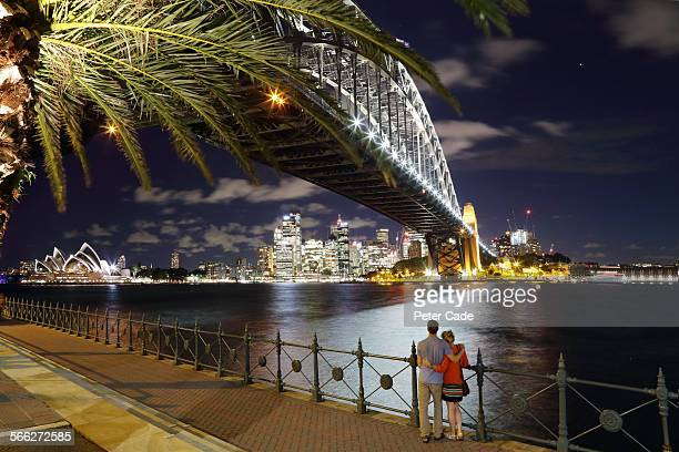 couple looking at Sydney city scape at night