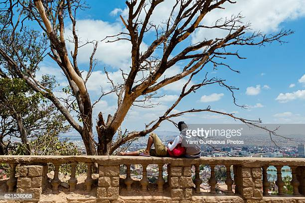 Couple looking at the city from the upper town, Antananarivo, Madagascar