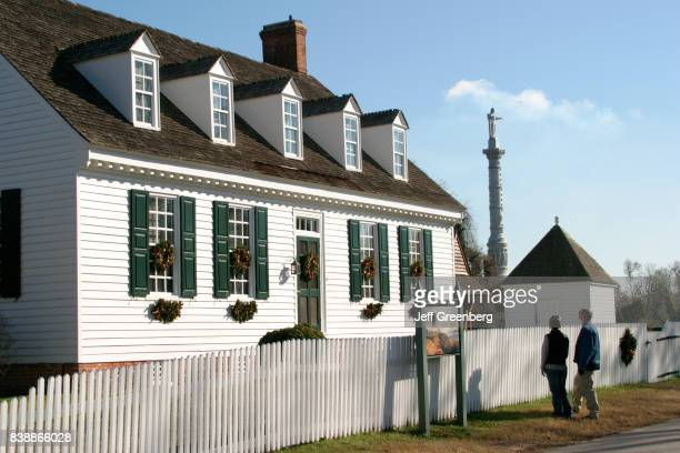A couple looking at the exterior of Dudley Digges House