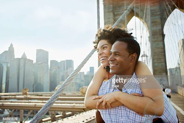 Couple Looking at the View from Brooklyn Bridge