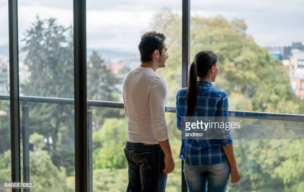 Couple looking at the view of their new house