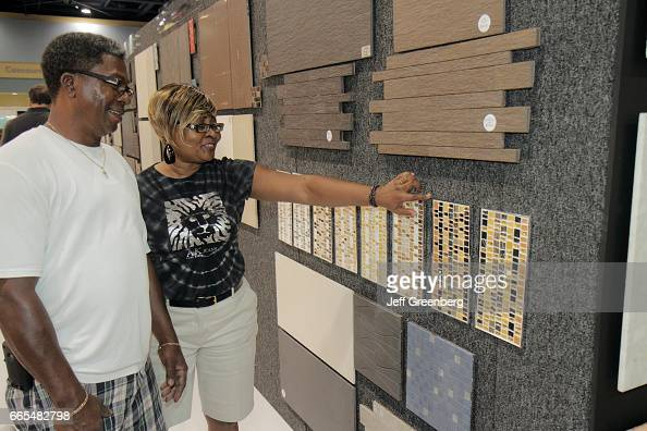 A couple looking at tile samples at the Home Design and Remodeling on home light show, crafts show, home art show, jewelry show, lighting show, food show, home repair show, technology show, office show, home show giveaways, home delivery show,