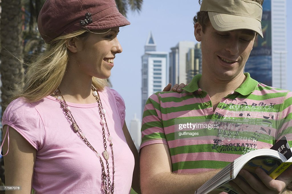 Couple looking at travel guide, United Arab Emirates : Stock Photo