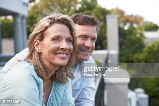 Couple looking away in balcony