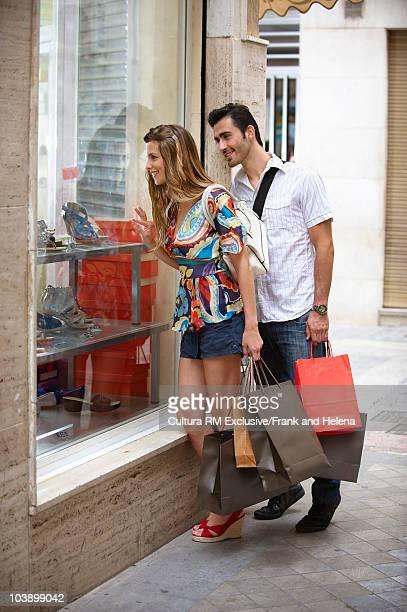 Couple looking into shop window