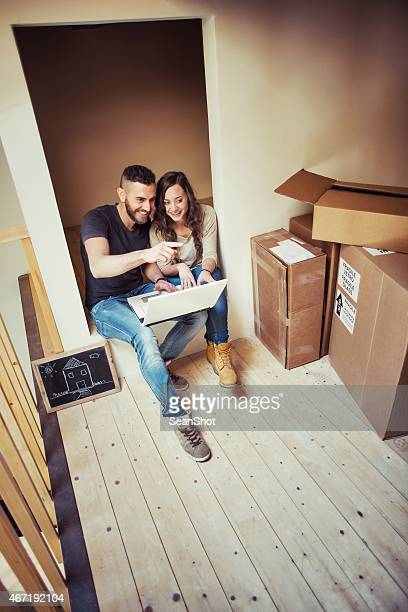 Couple looking laptop in a House During a Moving