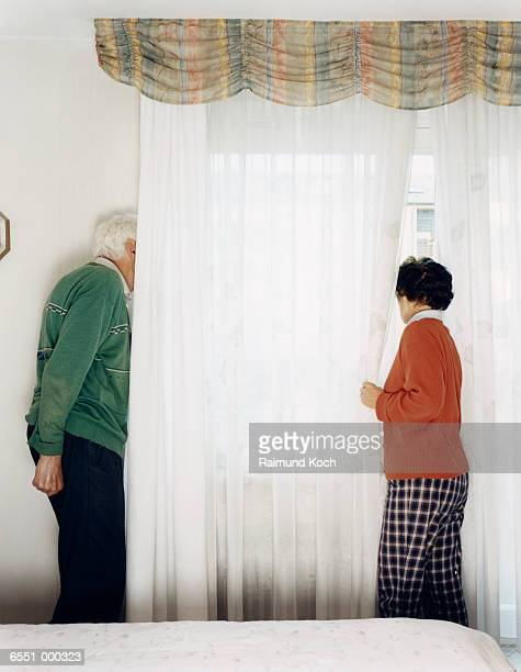 Couple Looking Out of Window