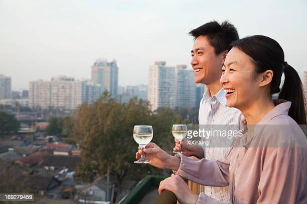 Couple Looking Out Over Cityscape