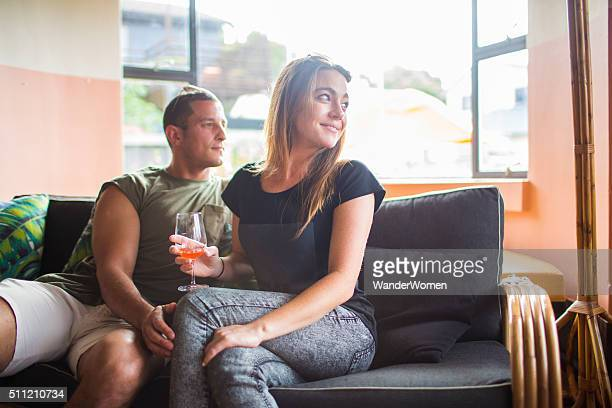 Couple looking out window with galss of wine