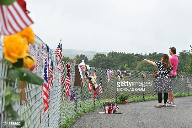 A couple looks at the field in Shanksville Pennsylvania on September 9 where United flight 93 crashed on September 11 2001 The US prepares to mark...