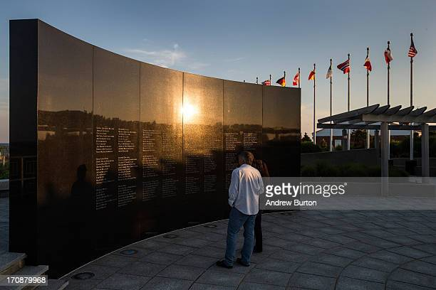 A couple looks at the TWA 800 International Memorial dedicated to the 230 people who died from an explosion on flight TWA 800 in 1996 on June 19 2013...
