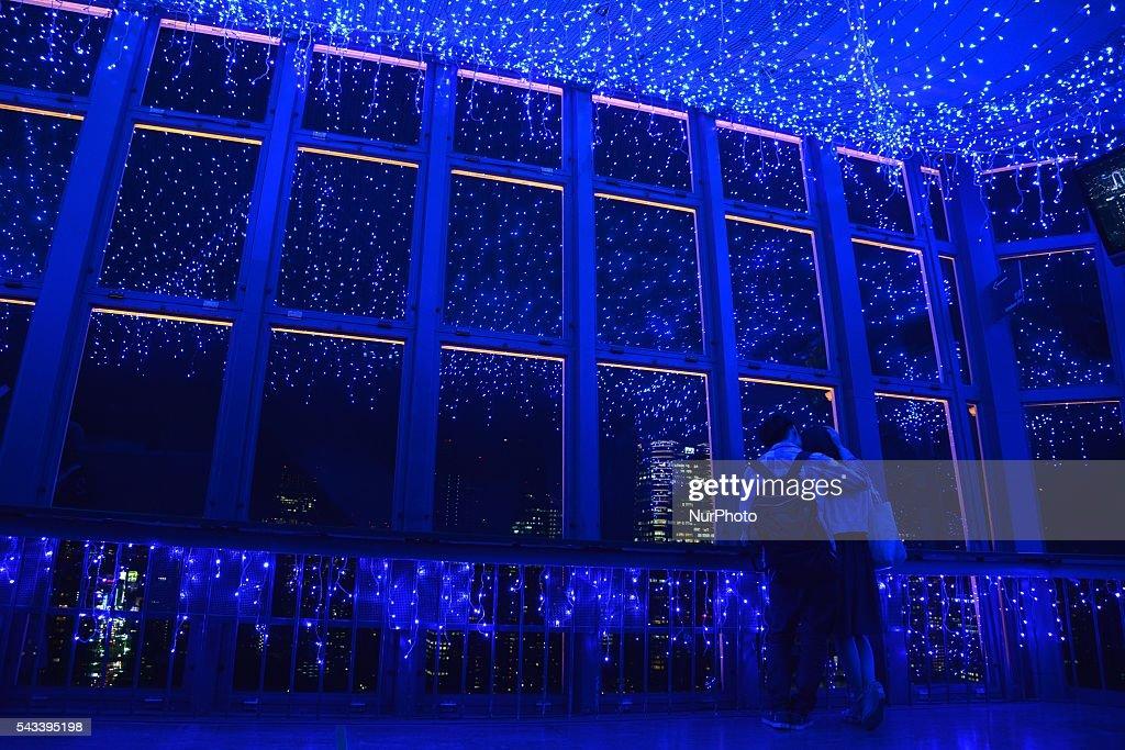 A couple looks over the night view under illuminated Milky Way at Tokyo Tower in Tokyo, Japan, 28 June 2016. Some 160,000 blue LED lights are used for the illuminations during Tanabata Festival, or Star Festival.