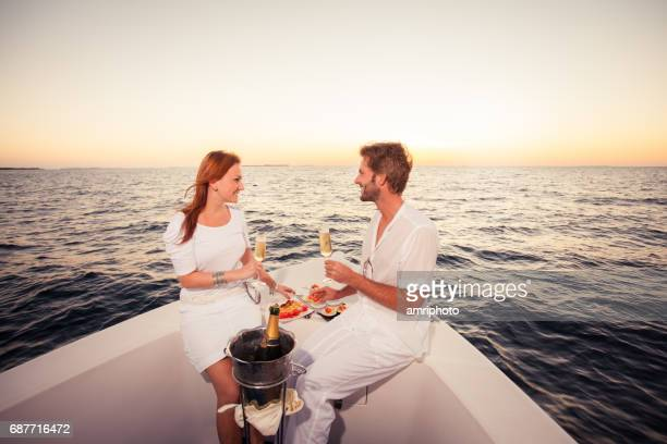 couple love sunset boat