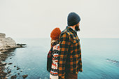 Couple lovers Man and Woman standing backs together Love and Travel happy emotions Lifestyle concept. Young family traveling romantic vacations autumn winter season