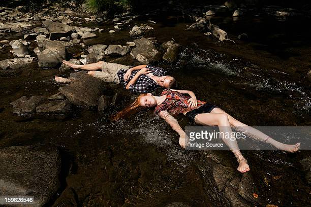 Couple lying down in river