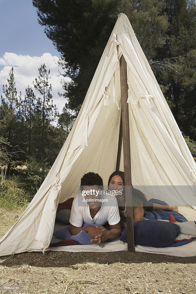 Couple lying down in tent : Stock Photo