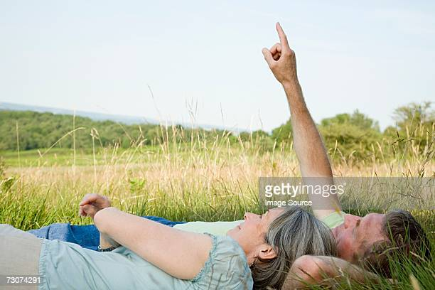 Couple lying in a field