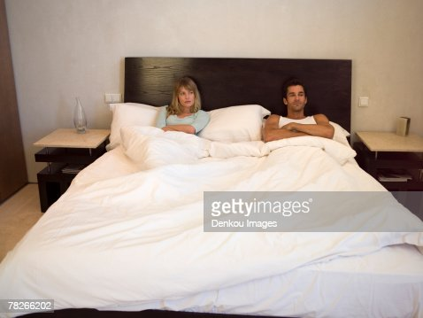 Couple lying in bed : Stock Photo