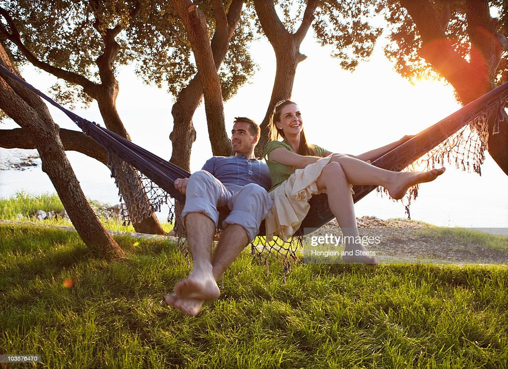 Couple lying in hammock at beach