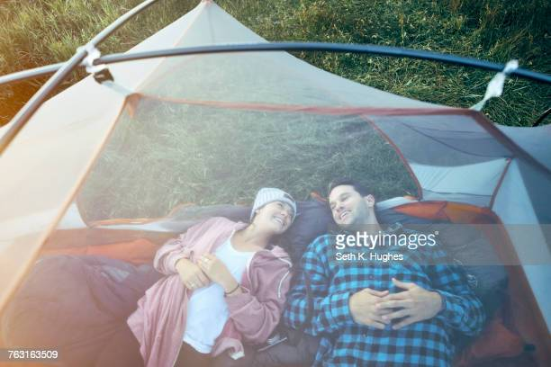 Couple lying in tent, elevated view
