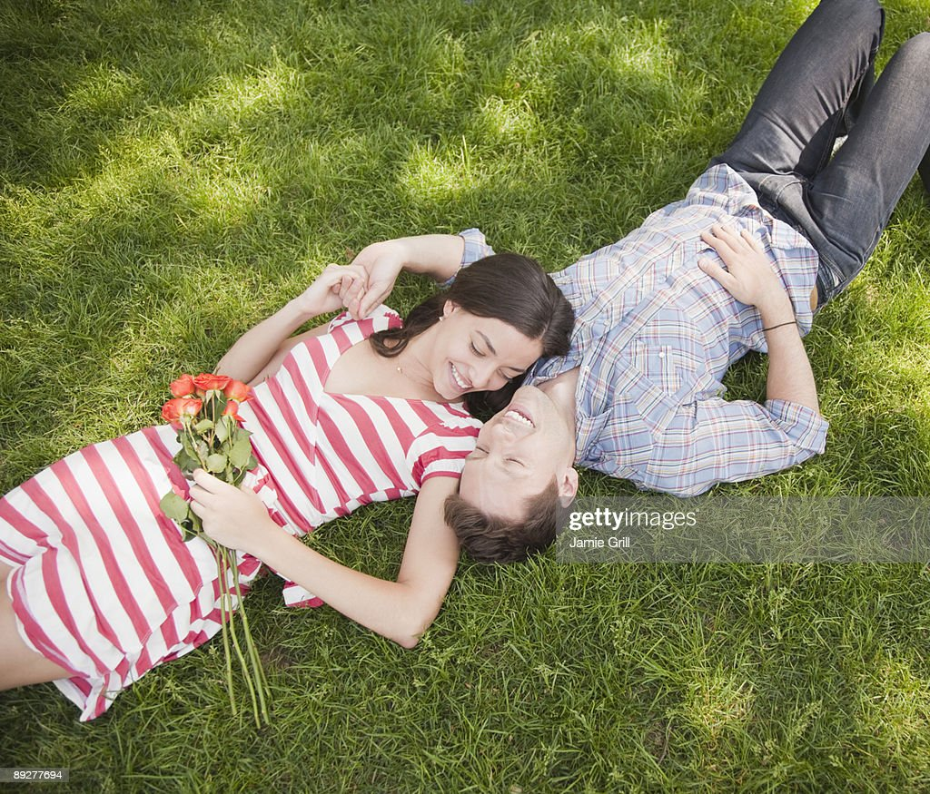 Couple Lying in the Grass : Stock Photo