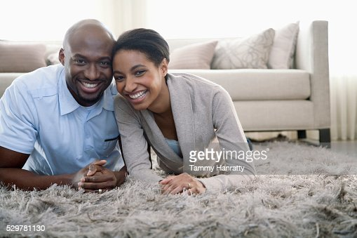 Couple lying on a rug : Stock Photo