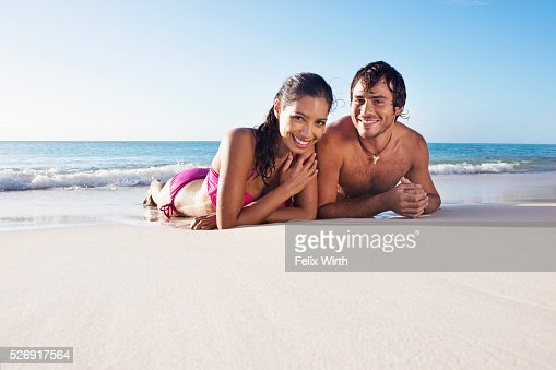 Couple lying on beach : Stock Photo