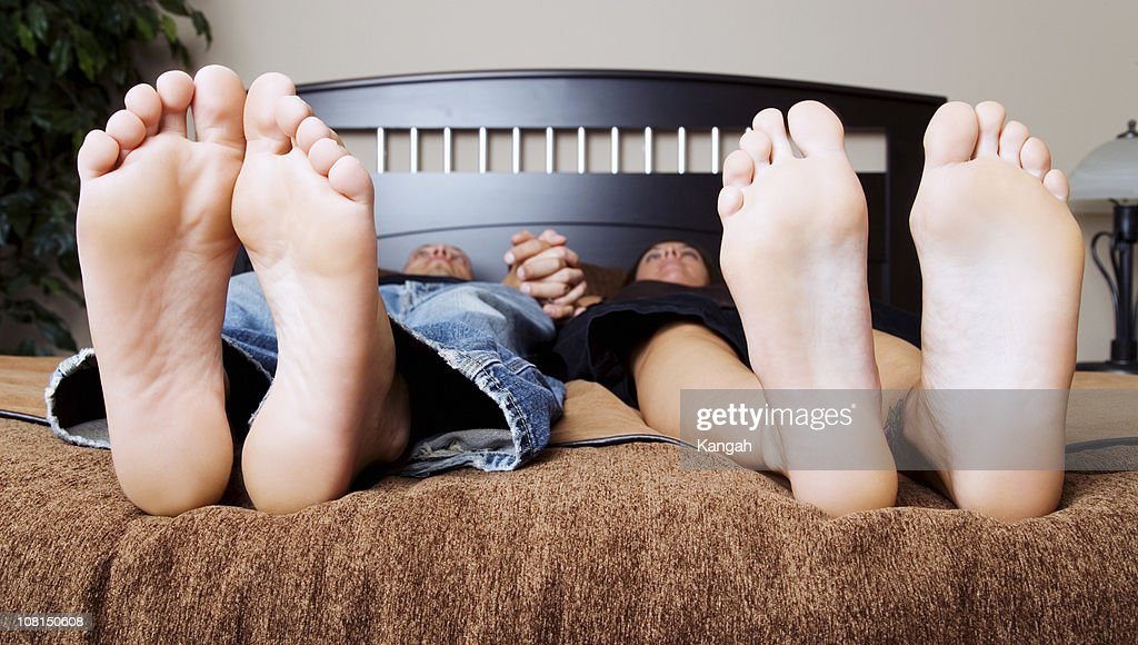Couple Lying on Bed : Stock Photo
