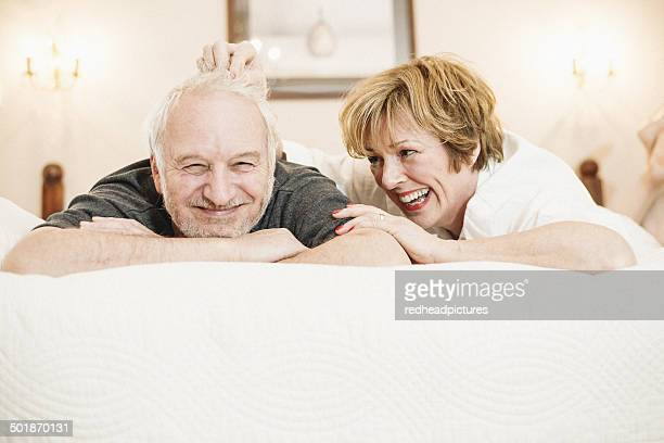 Couple lying on bed, portrait