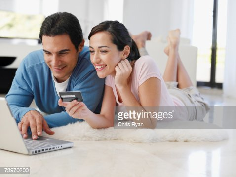 1 item added to cart  CONTINUE SHOPPINGCHECKOUT. Couple Using Computer To Shop At Home Stock Photo   Getty Images