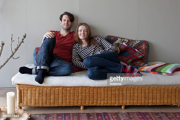 Couple lying on sofa, portrait