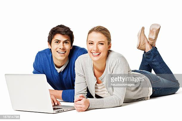 Couple Lying on the Floor With a Laptop - Isolated
