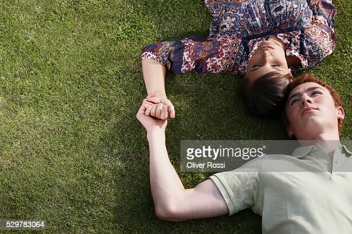 Couple Lying on the Grass : Photo