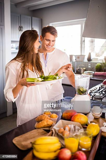Couple making a fresh smoothie for breakfast