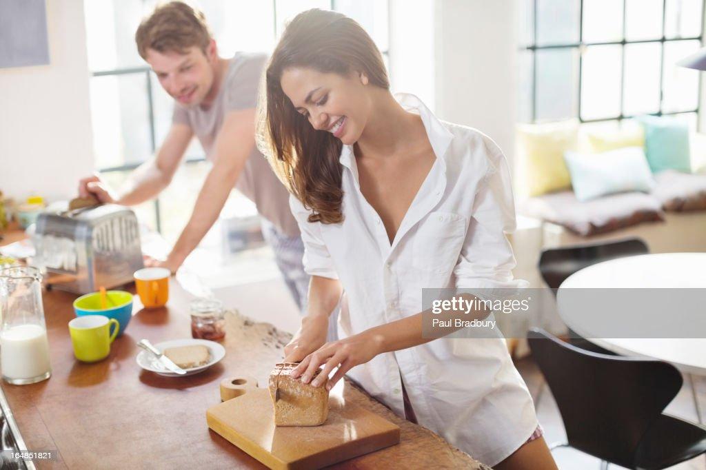 Couple making breakfast in kitchen : Stock Photo