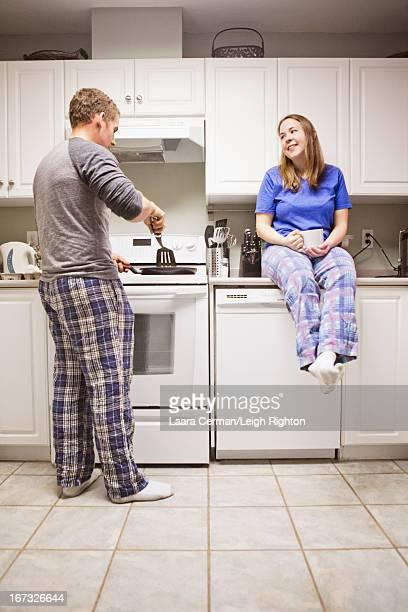 Couple making breakfast.