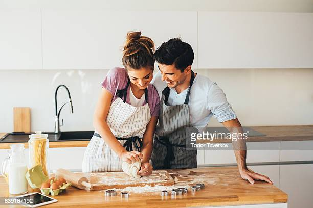 Couple making cookies