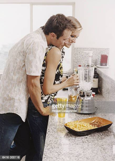 Couple Making Drinks