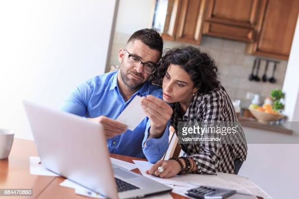 Couple making home finances