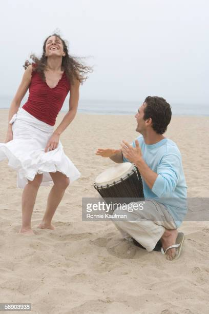 Couple making music on the beach
