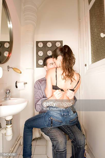 A couple making out in a bathroom