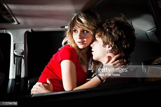 Couple making out in back seat of car