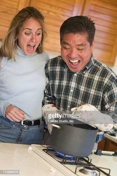 Couple making popcorn