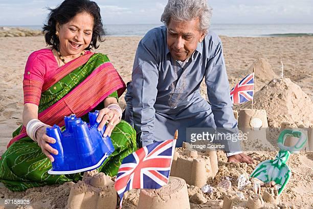 Couple making sandcastles