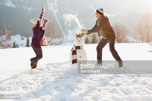 Couple making snowman