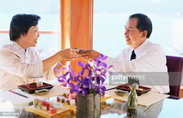 Couple Making Toast with Sake