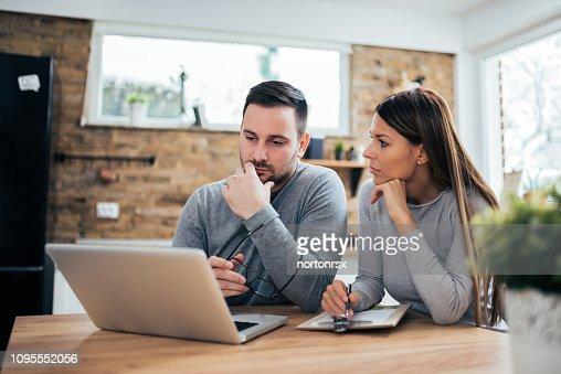 Couple managing finances. : Stock Photo