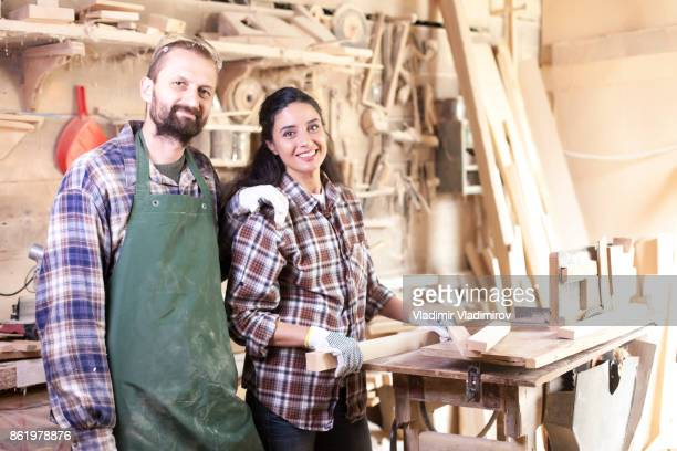 Couple manual workers working in atelier
