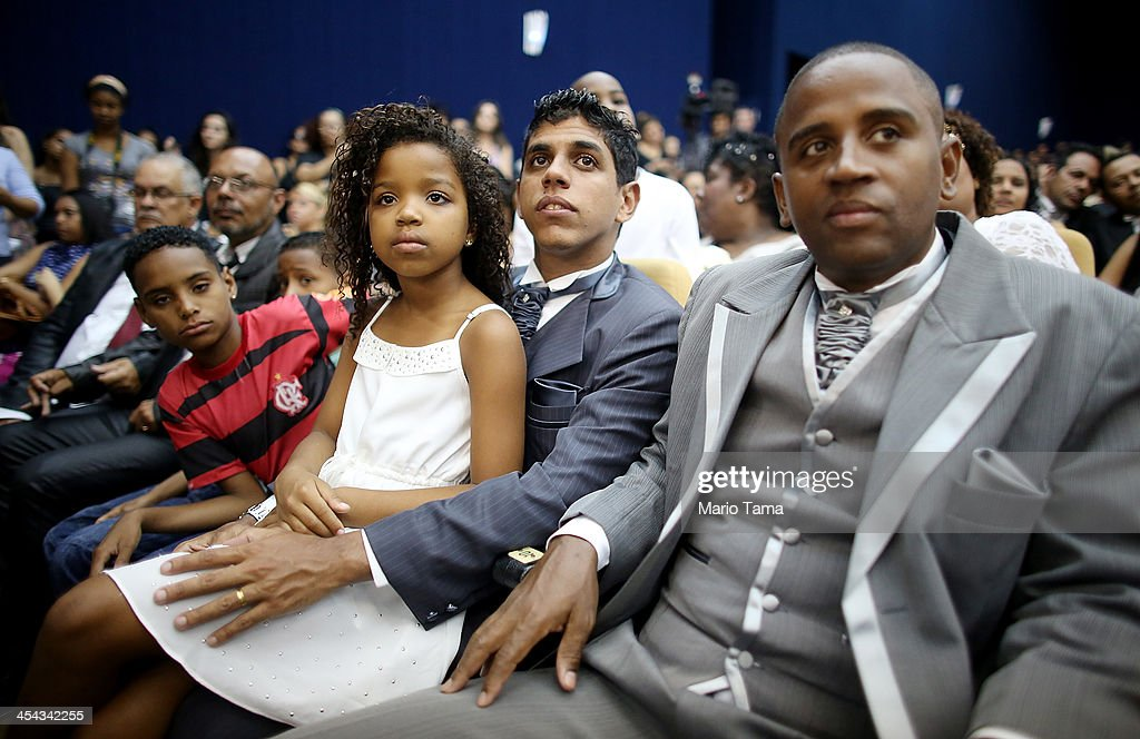 Couple Marcel (R) and Geraldo sit with their daughter Kevellen, 8, before marrying at what was billed as the world's largest communal gay wedding on December 8, 2013 in Rio de Janeiro, Brazil. 130 couples were married at the event which was held at the Court of Justice in downtown Rio. In May, Brazil became the third country in Latin America to effectively approve same-sex marriage via a court ruling, but a final law has yet to be passed.