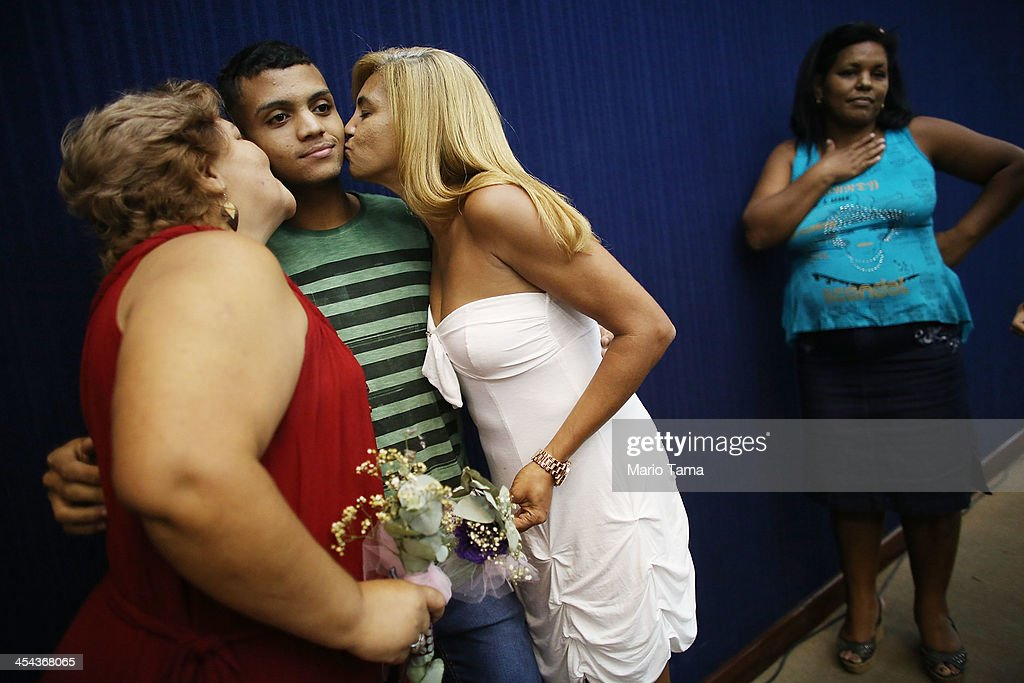 Couple Marcia (L) and Jaqueline kiss Marcia's son Gustavo while posing before marrying at what was billed as the world's largest communal gay wedding on December 8, 2013 in Rio de Janeiro, Brazil. 130 couples were married at the event which was held at the Court of Justice in downtown Rio. In May, Brazil became the third country in Latin America to effectively approve same-sex marriage via a court ruling, but a final law has yet to be passed.